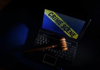 Gavel on laptop crime scene