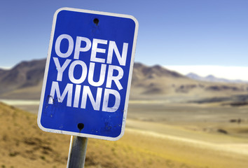 Open Your Mind sign with a desert background