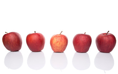 A group of red apples over white background