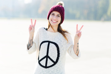 Girl showing peace sign