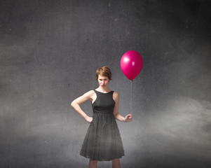 adult girl with balloon on hand