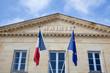 Leinwanddruck Bild - Jolie mairie avec drapeaux