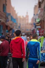 People walking and shopping in the old street of Tiznit, Morocco