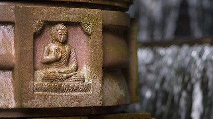 Antique stone carving of buddha.