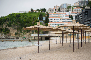 Empty beach with umbrellas, Budva, Montenegro