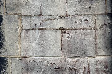 Old gray brick wall