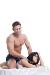 Smiling man doing massage to his mistress