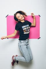 Cheerful girl posing at camera