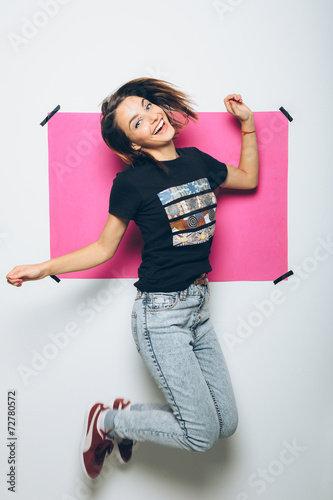 canvas print picture Cheerful girl posing at camera