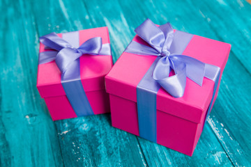 Pink gift boxes on blue wood