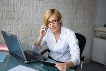 Professional businesswoman calling by cell