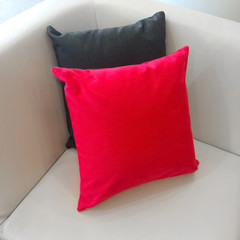 Sofa corner with red and gray cushions