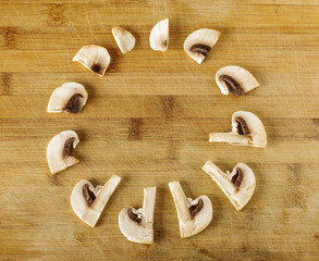 Champignon slices assembled as a clock creative photography