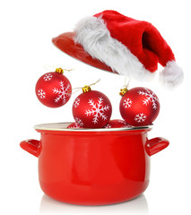 Cooking pot with Christmas ornaments and santas hat