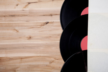 top view of vinyl records over wooden table