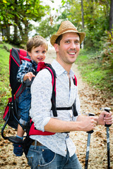 Baby with father travelling with son in the backpack