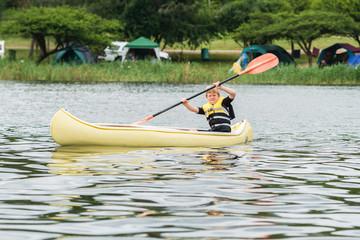 Boy Canoeing Dam