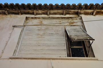 window shutter stained wall