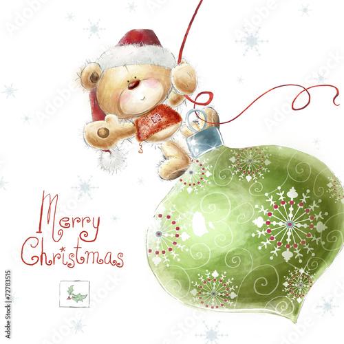 Cute teddy bear with  big Christmas tree toy  in Santa hat.