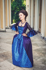 Beautiful woman in blue medieval dress
