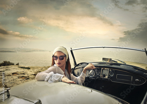 Classy woman in a vintage car - 72783972