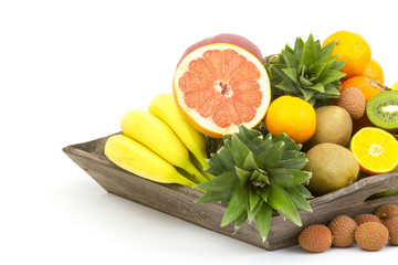 fresh fruit on a wooden tray