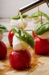 Season caprese salad with olive oil