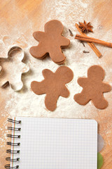 Christmas list. The dough for gingerbread. Notebook, gingerbread