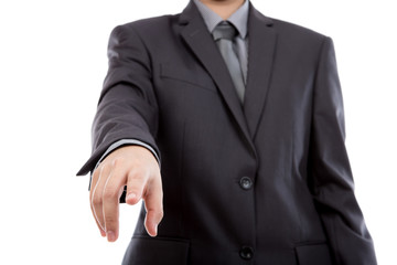 Business man touching an imaginary screen against white backgrou
