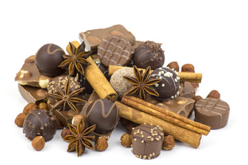 chocolate, spices and nuts on white background
