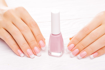 beautiful french manicure isolated on white
