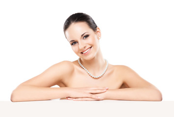 Portrait of a beautiful woman in a pearl necklace