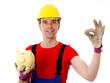 workman with piggy bank making agood job
