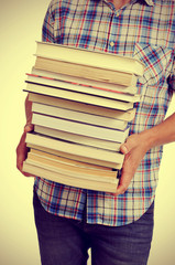 young man with books, with a filter effect