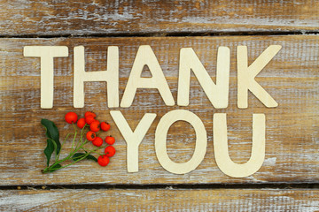 Thank you written with wooden letters on rustic wooden surface