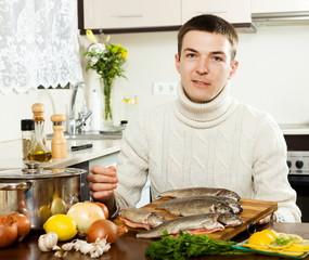 man with salmon fish
