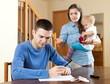 Family of three with baby having quarrel