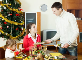 Happy family  over holiday table at home interior