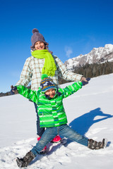 Happy kids playing winter