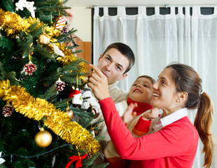 family of three preparing for Christmas