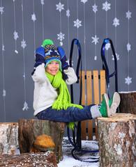 Winter Fashion. Portrait of adorable happy boy.