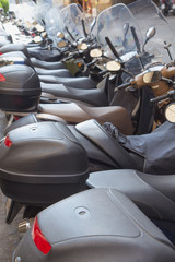 Scooters parked in a row