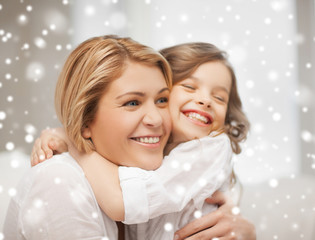 happy mother and daughter hugging at home