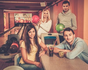 Group of young people behind table in bowling club