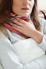 Feeling sick woman in the scarf