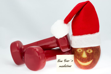 Dumbbells, apple and red hat