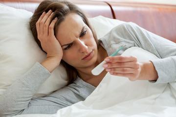 Getting the flu woman taking temperature