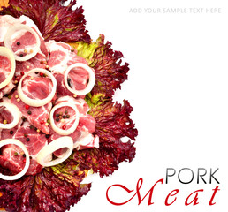Raw meat pieces with sliced onion and black pepper