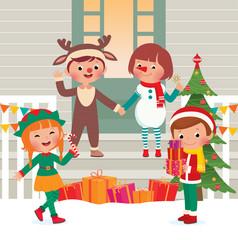Children on the doorstep in Christmas Costumes