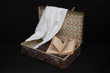 Old Suitcase With Book and Clothes